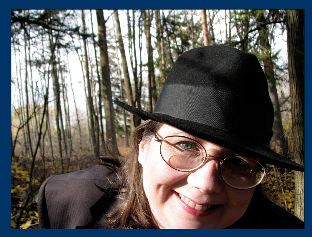 off center autumn photograph of the author in the woods