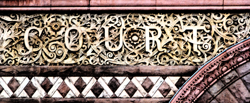 "The word court cast into the ornate doorway over Toronto's ""Old City Hall"" which today is entirely used as a court house."