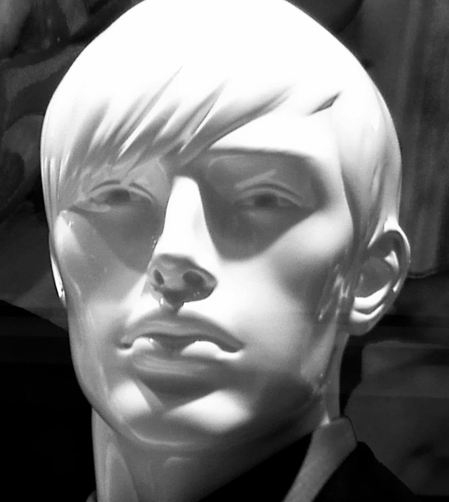 black and white photo of a male mannequin